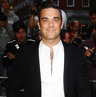 Robbie Williams says he avoids alcohol so he can stay faithful
