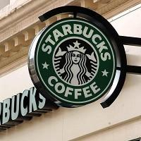 Starbucks expects to pay around 10 million pounds in UK corporation tax in each of the next two years