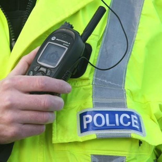 A police officer has died in a road accident while answering an emergency call