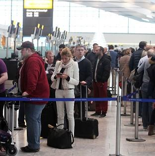 Preston and Leyland Citizen: Passengers queue to check in and to rebook tickets at Terminal 5 of Heathrow Airport following a technical problem at the National Air Traffic Services (Nats) control centre in Swanwick