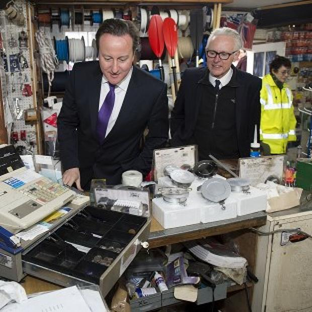 Preston and Leyland Citizen: Prime Minister David Cameron sees flood damage at Wells-next-the-Sea, Norfolk