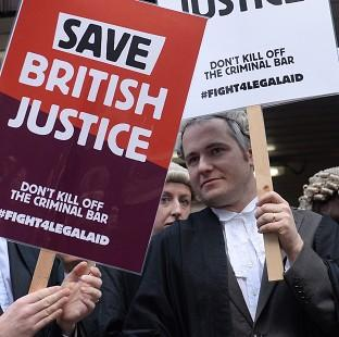 Barristers protest against Government plans to cut legal aid fees.
