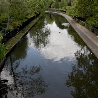 The bodies of two men have been found at a canal in Gloucestershire, police said