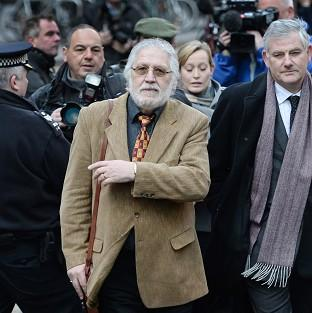 Preston and Leyland Citizen: DJ Dave Lee Travis, centre, arrives at Southwark Crown Court in London