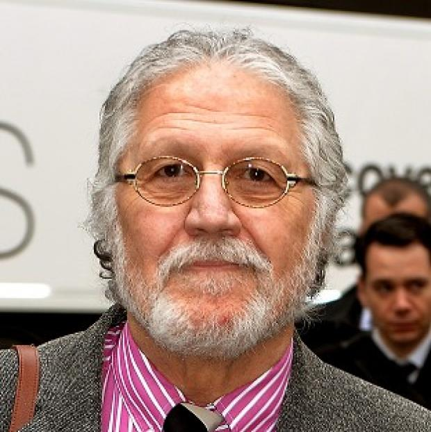 Preston and Leyland Citizen: DJ Dave Lee Travis arrives at Southwark Crown Court in London, where he is accused of 13 counts of indecent assault and one count of sexual assault in 2008