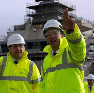 Preston and Leyland Citizen: Labour leader Ed Miliband, right, visits Rosyth Dockyard in Fife