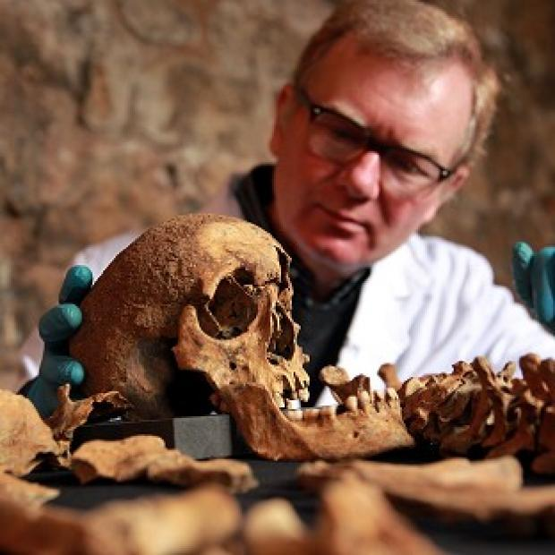 Preston and Leyland Citizen: Osteologist Don Walker with some of the skeletons that were discovered last year by Crossrail during construction works in Charterhouse Square