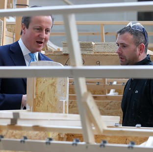 Prime Minister David Cameron talks to frame assembler Darren Jones during a visit to Westbridge Furniture Ltd, a sofa manufacturers in Greenfield, North Wales