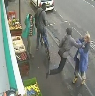 CCTV image of the moment Andrew Young was killed with a single punch by Lewis Gill, whose jail sentence is to be reviewed (PA/Dorset Police)