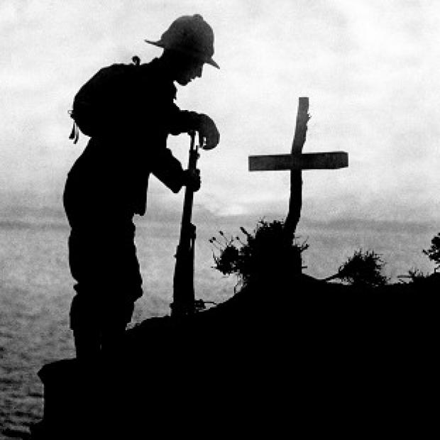 Preston and Leyland Citizen: A British soldier pays his respects at the grave of a colleague after the Gallipoli landings in 1915