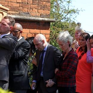 Judy Murray with Nino Severino follows the coffin of former tennis player Elena Baltacha into church.