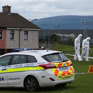 Preston and Leyland Citizen: Members of the Garda forensic team at the crime scene in Croftwood Gardens, Dublin, where a six-year-old boy was shot