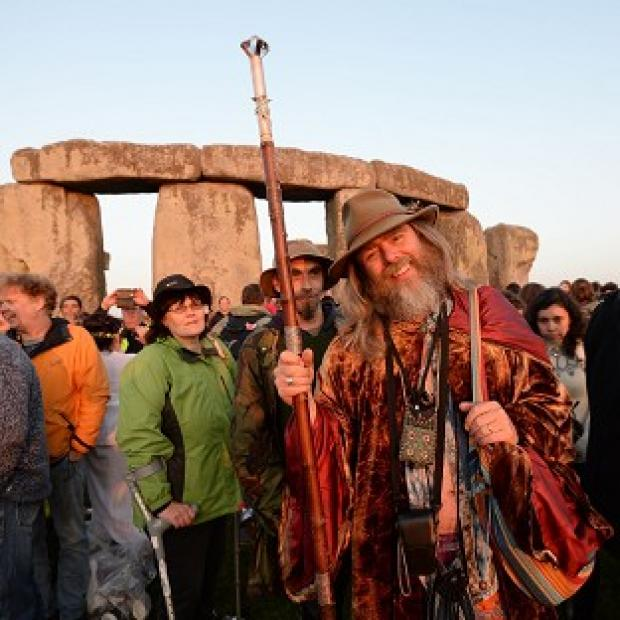 Preston and Leyland Citizen: Crowds gather at dawn amongst the stones at Stonehenge in Wiltshire for the Summer Solstice.